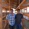 Father and son, Oscar Omar and Melvin Alonzo standing with Coffee Drying Beds at Finca Californeo